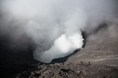 Active volcano crater with smoke Royalty Free Stock Images