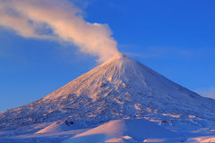Active volcano of Kamchatka: eruption Klyuchevskoy Volcano at sunrise Royalty Free Stock Images