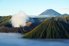 Active Volcano - Mount Bromo and Semeru. Active Volcano, Java, Indonsia - Mount Bromo (front-left). Taken not long after sunrise. Mount Semeru (back-right). Deep Royalty Free Stock Images