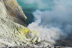 Active volcano with sulfur steaming. Active Ijen volcano crater, steaming, sulfur mining on crater, Java, Indonesia Stock Photography