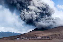 An active volcano at the Tengger Semeru National Park in East Java, Indonesia. Grey smoke coming out of an active volcano filling the sky at the Tengger Semeru Stock Image