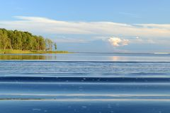 Active Water. Waves diverge on the lake surface Stock Photos