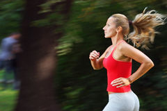 Active woman. Is running in a park Royalty Free Stock Photography