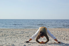 Active woman. Doing exercise on the beach Stock Photo