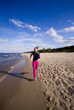 Active woman on the beach Stock Images
