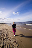 Active woman on the beach Royalty Free Stock Photos