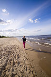 Active woman on the beach Royalty Free Stock Image