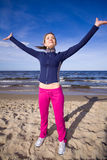 Active woman on the beach Stock Image