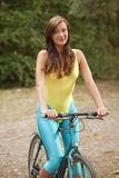 Active woman on bicycle Stock Photography