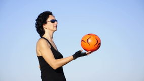 Active woman in black playing with ball stock footage