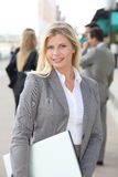 Active woman in business travel Stock Photography