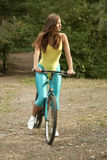 Active woman cycling Stock Image