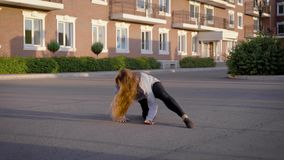 Active woman dancing hip-hop outdoor, beautiful jazz modern dance. Charming young woman freestyling in the city. Funky street dance stock footage