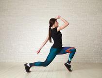Active woman doing fitness exercises in studio Stock Images