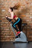 Active woman doing sport biking. Stock Photos