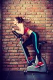Active woman doing sport biking. Stock Image