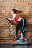 Active woman doing sport biking. Stock Images