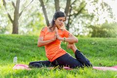 Active woman doing yoga poses at sunset Royalty Free Stock Image