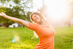 Active woman doing yoga poses at sunset royalty free stock images