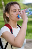 Active woman drinking water Royalty Free Stock Image