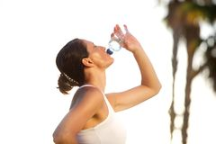 Active woman drinking water after exercise workout Stock Photo