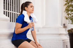 Active woman drinking water Royalty Free Stock Photography