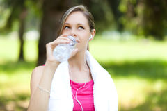 Active woman drinking water Stock Image