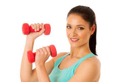 Active woman with dumbbells workout in fitness gym isolated over Stock Photography