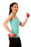 Active woman with dumbbells workout in fitness gym isolated over Stock Photo