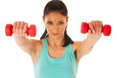 Active woman with dumbbells workout in fitness gym isolated over Stock Images