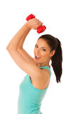 Active woman with dumbbells workout in fitness gym isolated over Stock Image