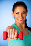 Active woman with dumbbells workout in fitness gym over blue bac Royalty Free Stock Images