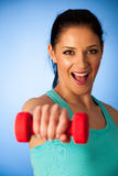 Active woman with dumbbells workout in fitness gym over blue bac Royalty Free Stock Photography