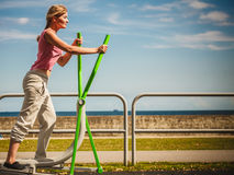 Active woman exercising on elliptical trainer. Royalty Free Stock Photography
