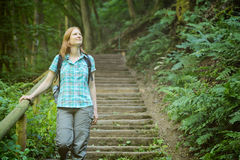 Active Woman Explores a Forest Stock Photography