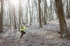 Active woman in forest Royalty Free Stock Photo