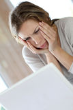 Active woman getting upset in front of laptop Stock Image