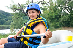 Active woman going river rafting Royalty Free Stock Photography