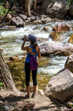 Active woman hiker hydrating Stock Photo