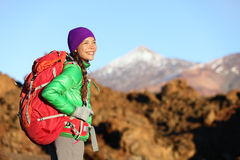 Active woman hiker living healthy lifestyle hiking. Outdoors wearing backpack smiling happy. Beautiful female trekking with looking with aspirations on Teide Royalty Free Stock Image