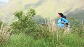 Active woman hiking on her own reading a map stock footage