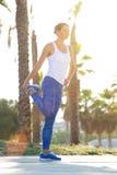 Active woman holding leg stretching exercise Stock Photo