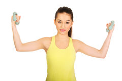 Active woman holding weights. Stock Image