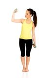 Active woman holding weights. Stock Photography