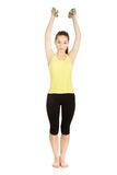 Active woman holding weights. Royalty Free Stock Photos