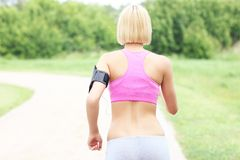 Active woman jogging in park Stock Photo