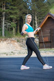Active woman jumping with skipping rope Royalty Free Stock Images