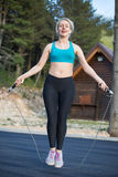 Active woman jumping with skipping rope Royalty Free Stock Photography