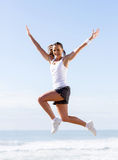 Active woman jumping Stock Photos