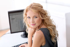 Active woman in office Royalty Free Stock Images